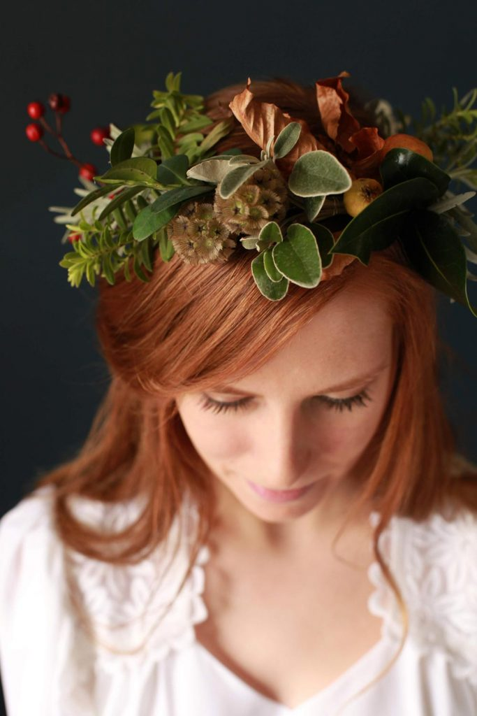Wintery crown made of foraged foliage and berries