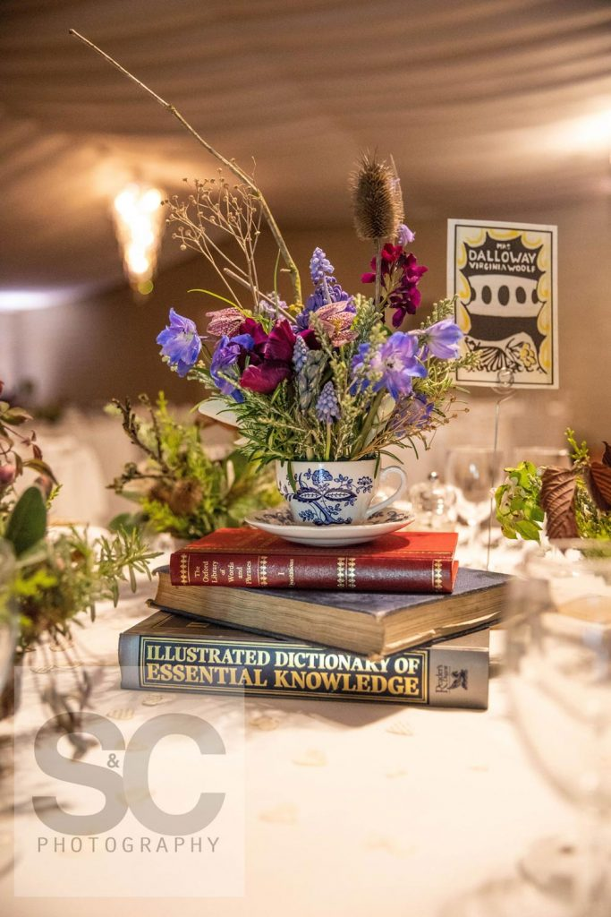 British wildflowers and foraged blooms in a china teacup as a floral centrepiece