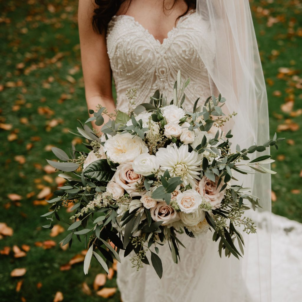 Bride holding a natural and sustainable wedding florals