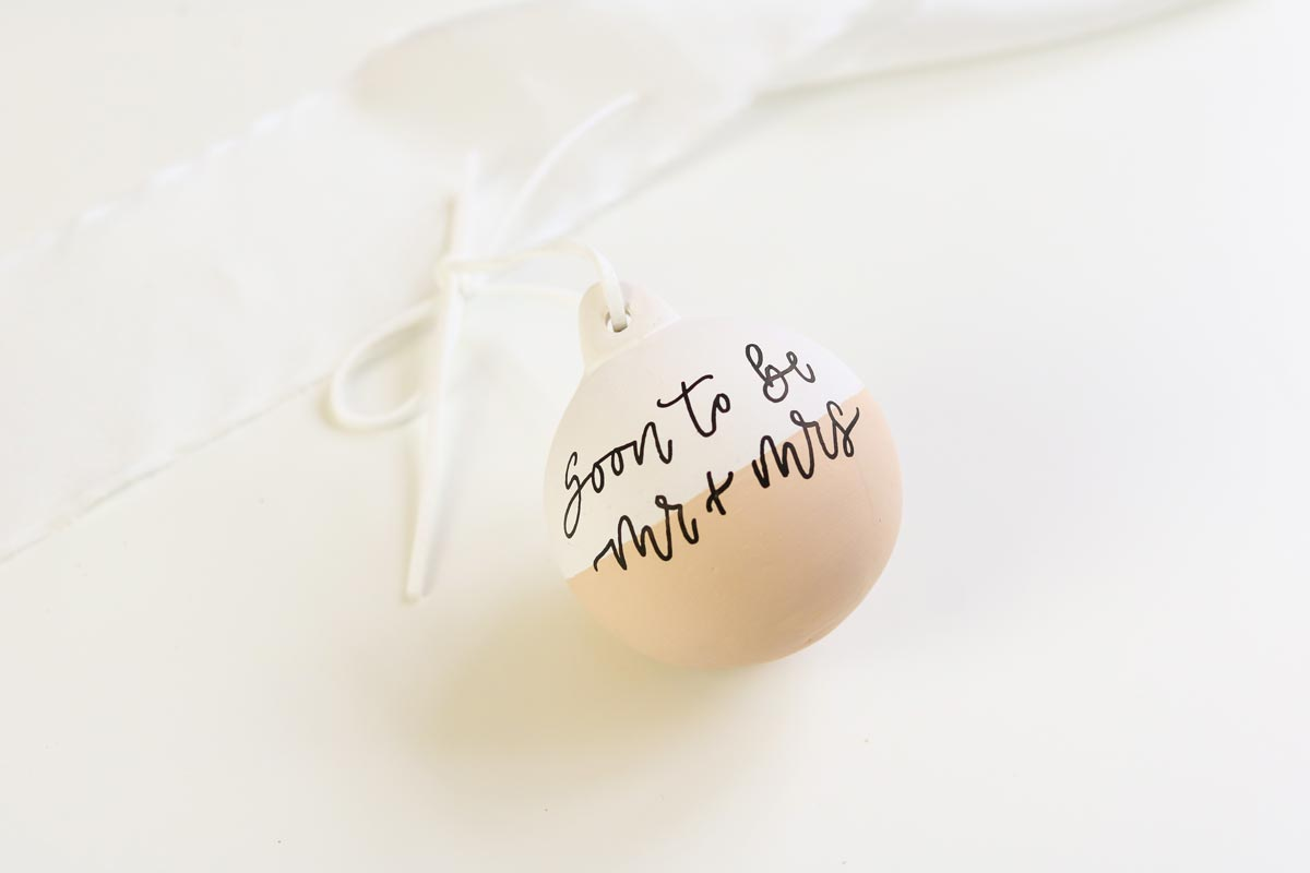 Half white and half beige Christmas bauble with 'soon to be mr and mrs'