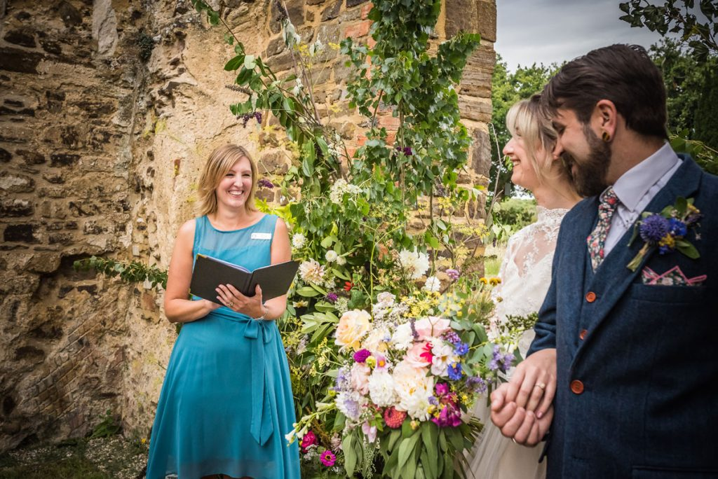 An independent celebrant conducts a ceremony inside a Sustainable Church Venue in Bedfordshire