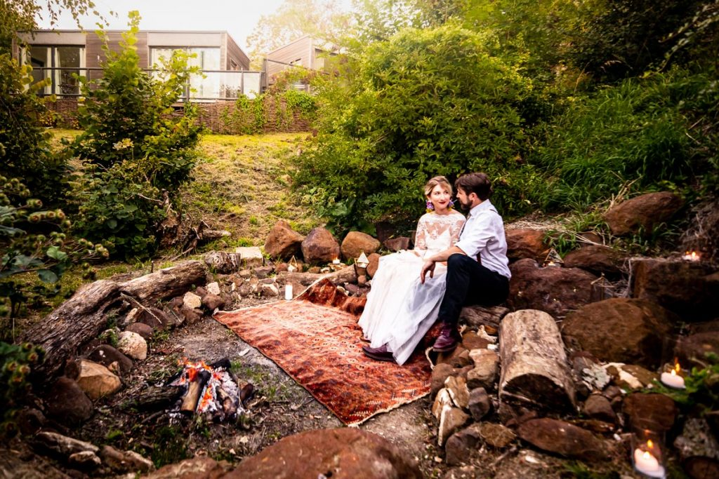 Newlyweds enjoy the firepit at Clophill Eco Lodges, Bedfordshire