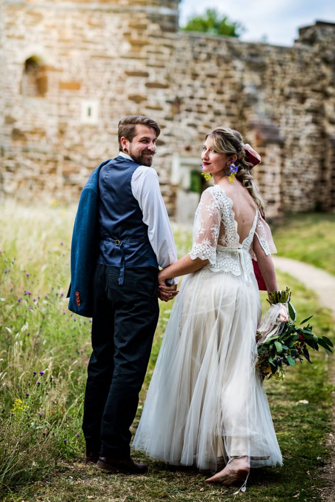 Newlyweds walking to the church at this sustainable Bedfordshire wedding venue
