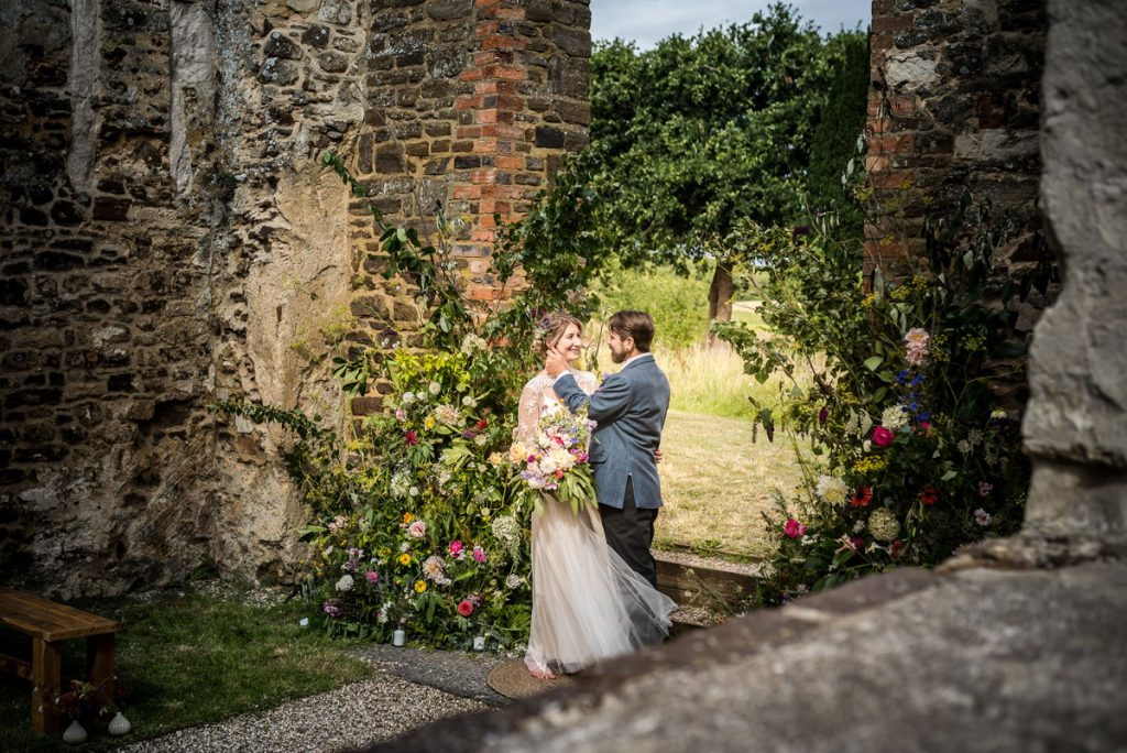 A unique sustainable wedding ceremony space in Bedfordshire, with the married couple enjoying a quiet moment amongst the church
